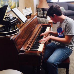 Lucas Wicks of Akron tickles the ivories for the residents at Harris Hill.