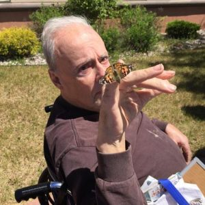 Harris Hill resident Tom McCorquodale, formerly of Wolcottsville, gets a close-up view of a Painted Lady butterfly.